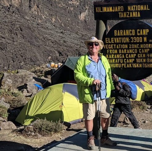 Rick Reichsfeld trekking up to the summit of Mt. Kilimanjaro